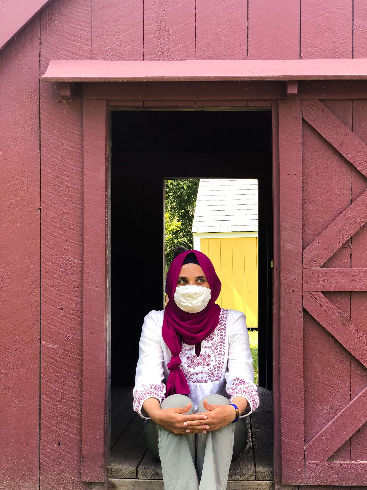 sitting in small barn entrance
