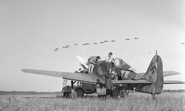 Stuka dive-bombers fly over, Immola, July 2, 1944.