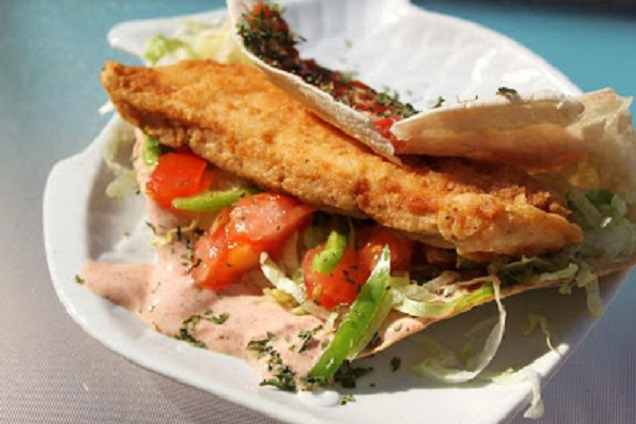 this is a deep fried piece of fish in a taco