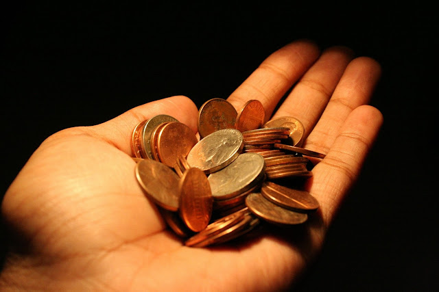 hand holding copper coins savings