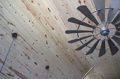 Kitchen remodel with vaulted ceilings, finished with tongue and groove pine and windmill fan from Shades of Light
