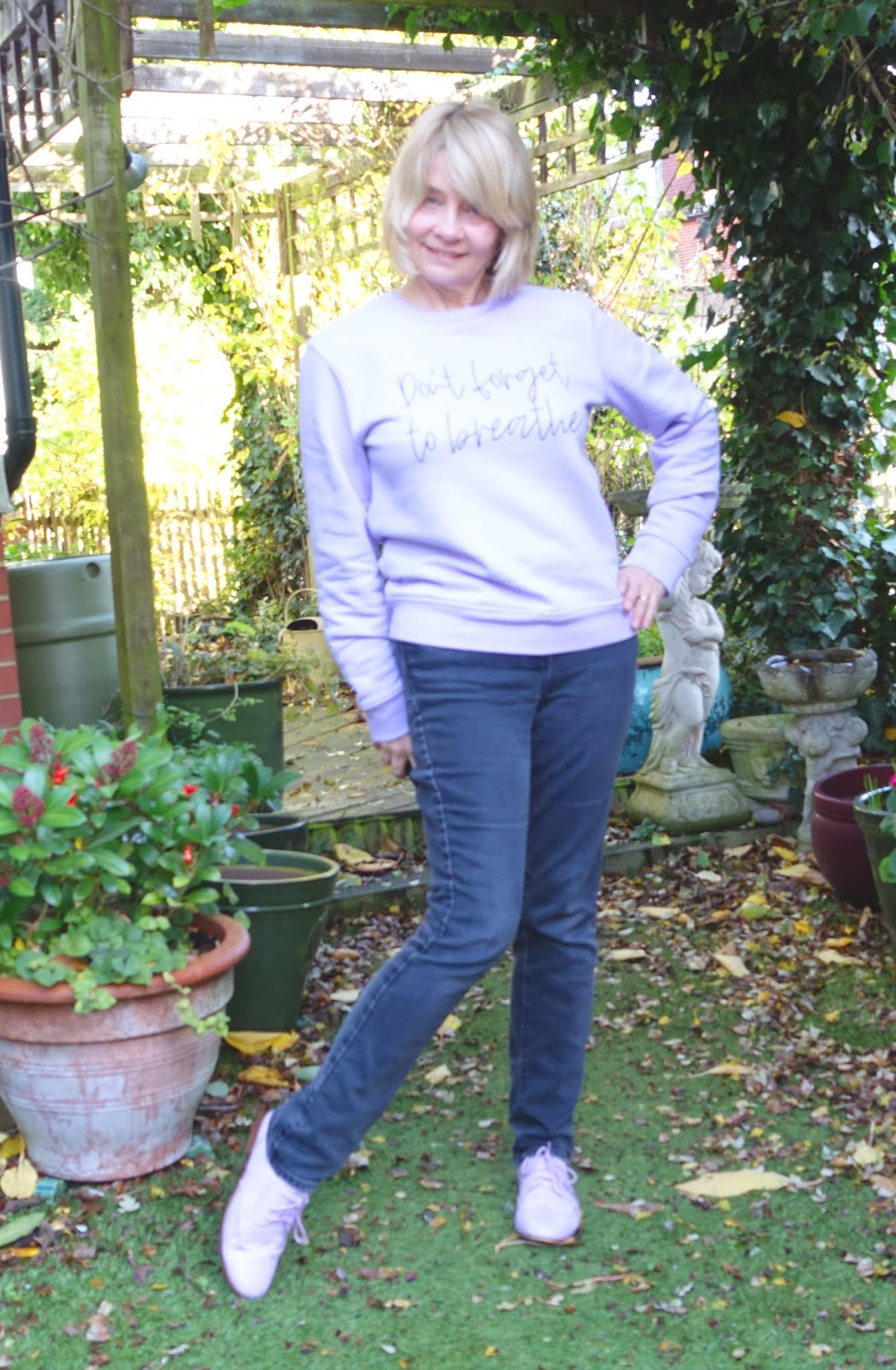Lilac yoga sweatshirt and jeans worn by style blogger Gail Hanlon from Is This Mutton?