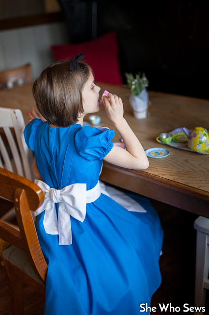 Girl playing dress up and having a teaparty