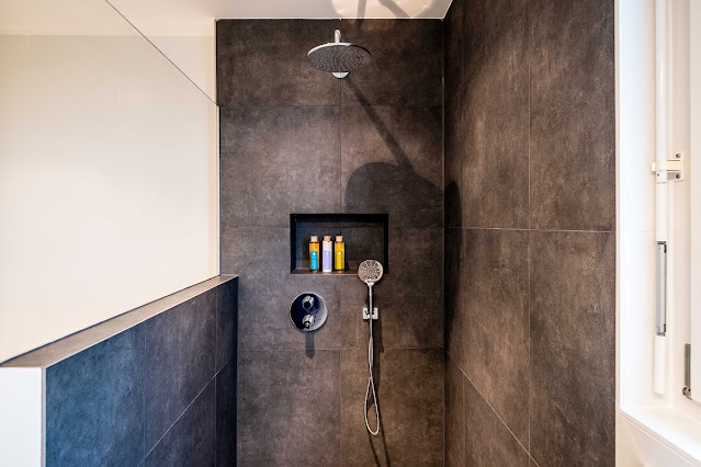 Hand held shower attachment at the perfect height for universal design.