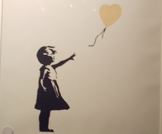 http://c300221.r21.cf1.rackcdn.com/girl-and-red-balloon-banksy-1391804646_org.jpg