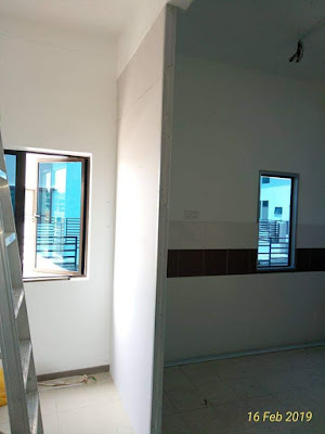 Divider gypsum board antara ruang tamu dan ruang dapur