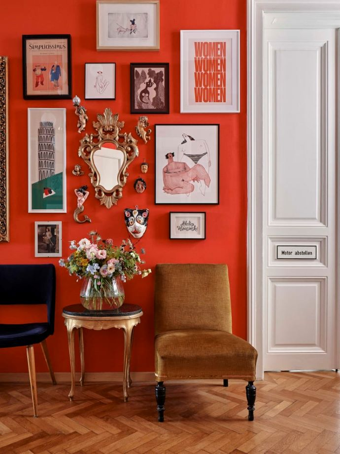Gallery wall on bright red wall