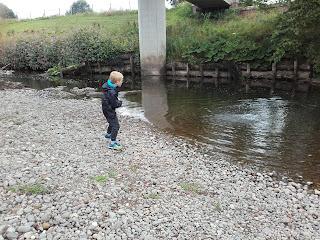 skimming stones into a stream
