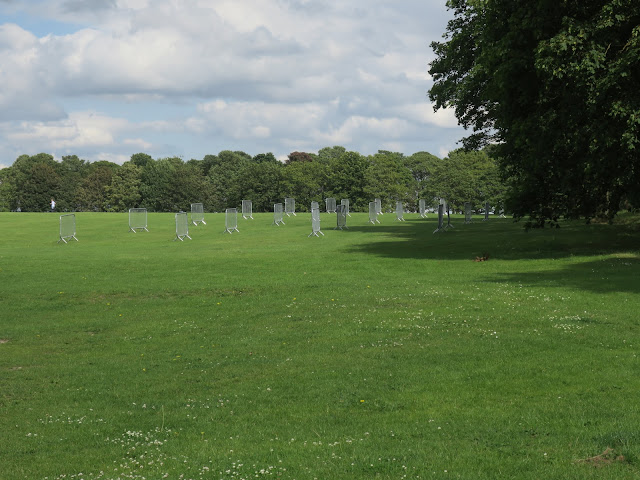 Barriers set out separately from each other on large expanse of grass. Temple Newsam Park.