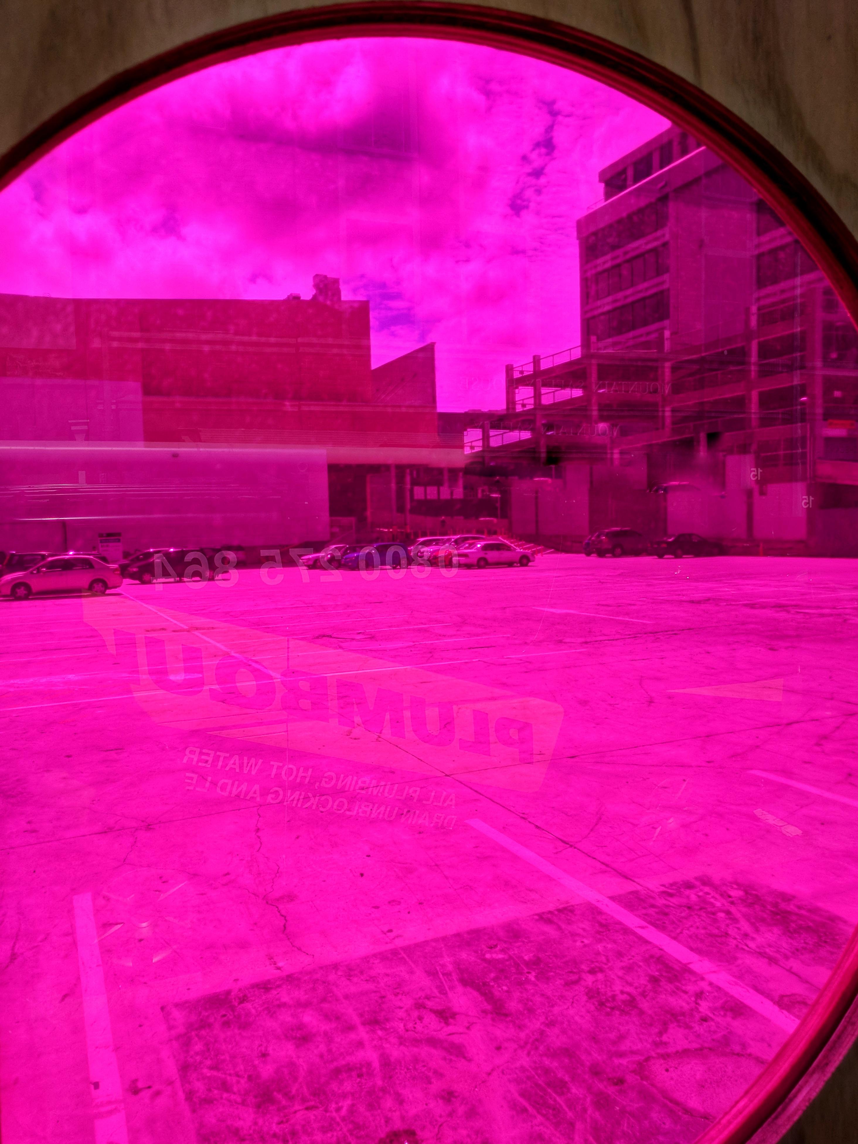Empty lot seen through a pink filter