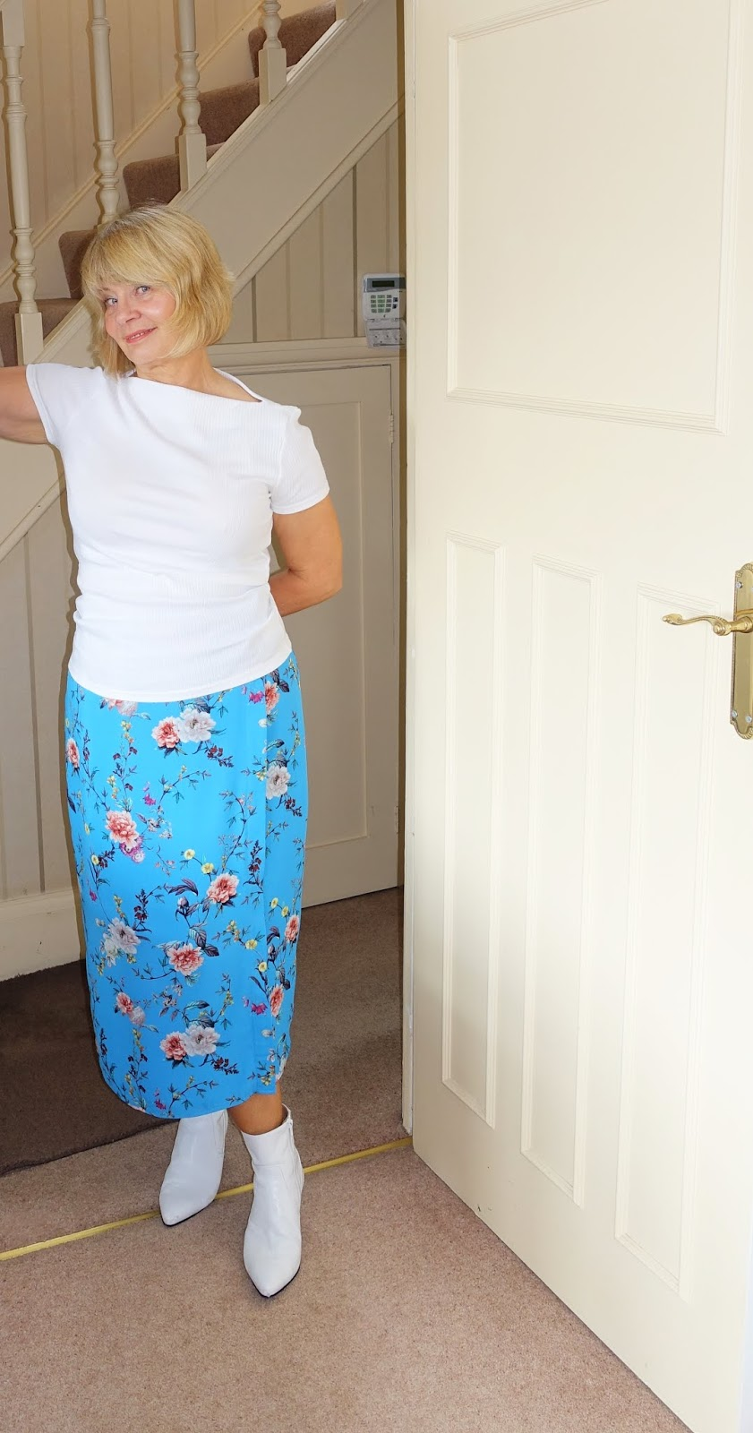 Is This Mutton the style blog shows how to style a print wrap summer skirt to wear it year-long