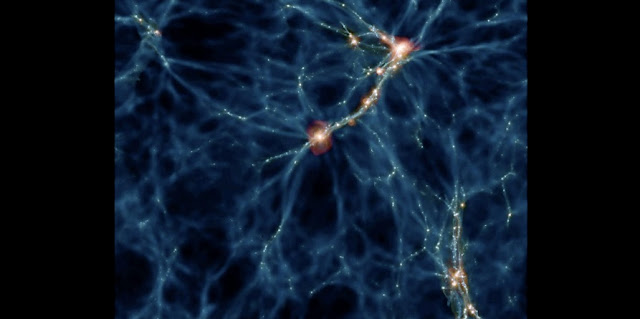 This is an image from the Romulus simulation depicting the network of structures that assemble on intergalactic scales, revealing where the galaxies hosting black holes form. More massive galaxies that host more massive black holes tend to live in hotter (red) regions, while lower-mass galaxies live in colder (blue) regions and harbor smaller black holes. Credit: Yale University