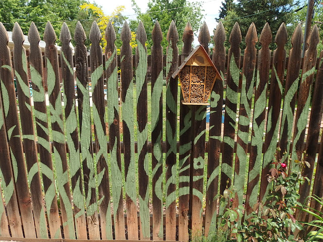Stencilled art gave this relatively boring fence a wow factor