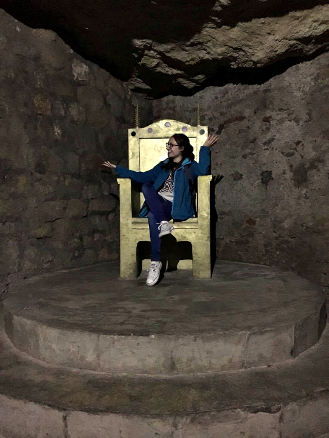 What to do in Budapest? Budapest castle labyrinth - sitting on the thrown
