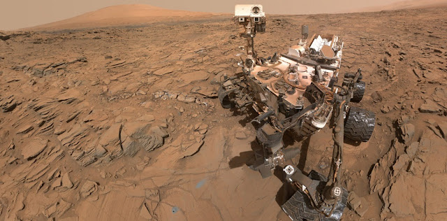"This May 11, 2016, self-portrait of NASA's Curiosity Mars rover shows the vehicle at the ""Okoruso"" drilling site on lower Mount Sharp's ""Naukluft Plateau."" The scene is a mosaic of multiple images taken with the arm-mounted Mars Hands Lens Imager (MAHLI). Credits: NASA/JPL-Caltech/MSSS"