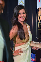 Varalakshmi in Cream Saree Sleeveless Backless Deep Neck Choli at IIFA Utsavam Awards March 2017 004.JPG
