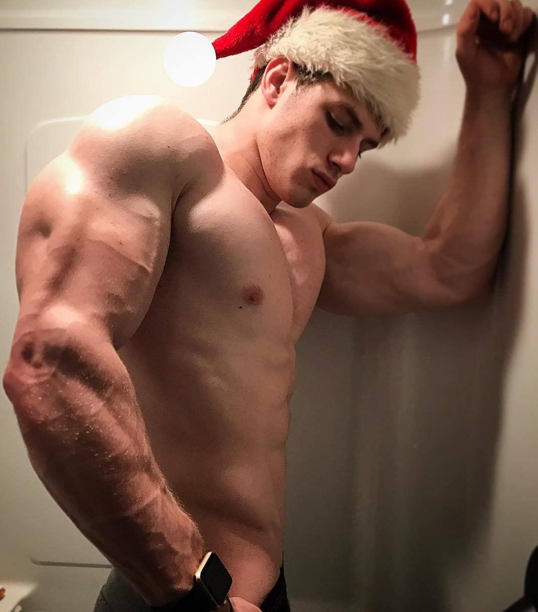 young-beefy-bro-shirtless-swole-muscle-body-santa-claus-biceps-hunk