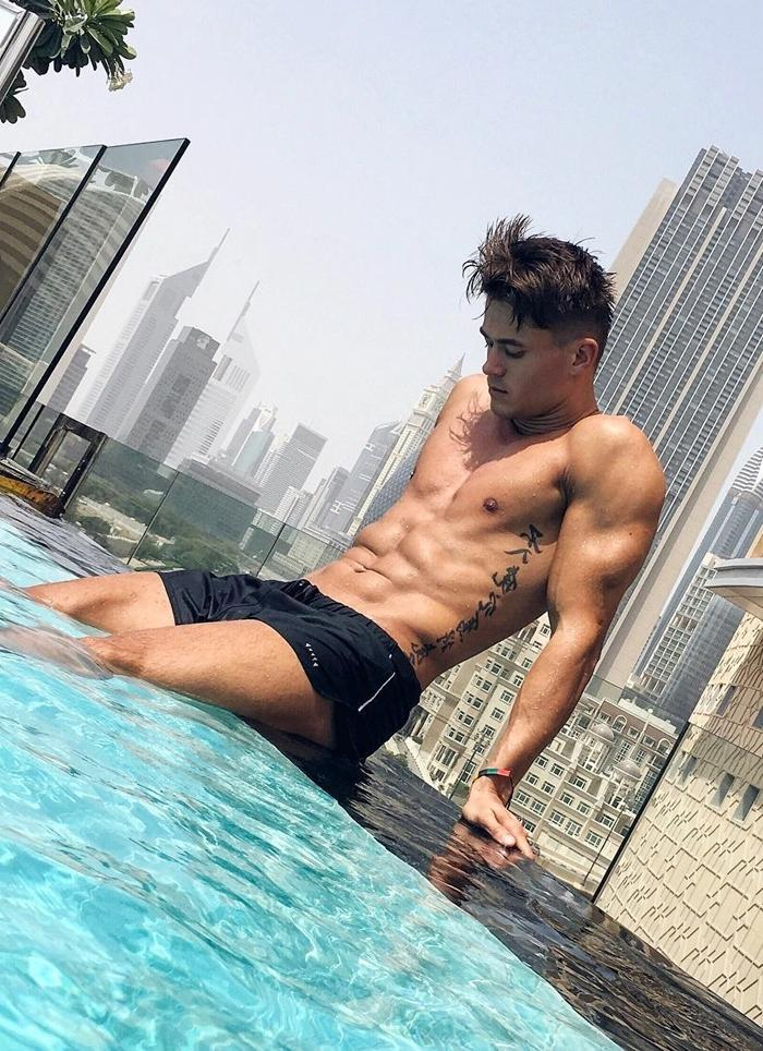 cute-shirtless-asian-male-stud-abs-tattoo-hairstyle-pool