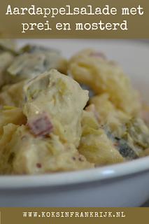 Aardappelsalade met appel, prei, spekjes en mosterd