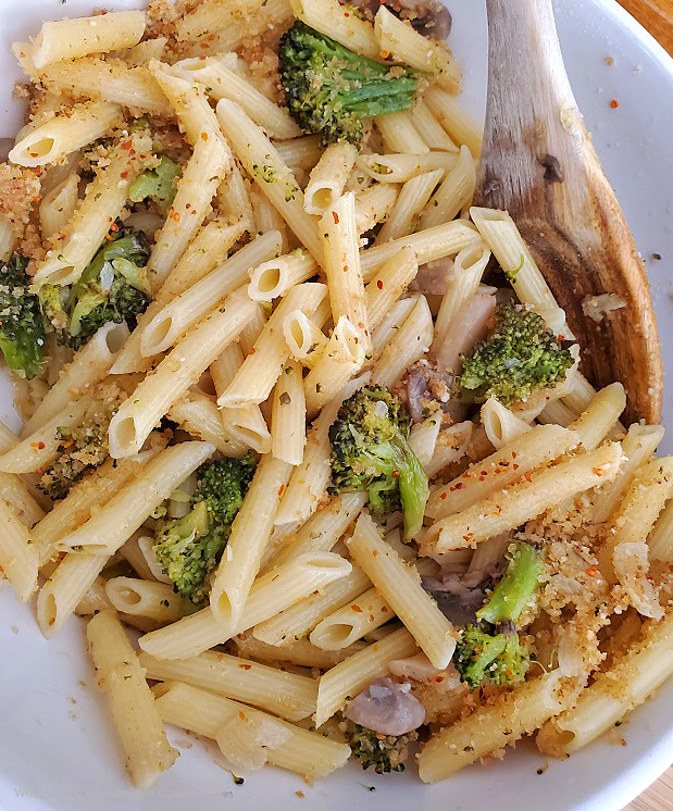 this is penne pasta with toasted bread crumbs, garlic, oil, broccoli, mushrooms tossed in a casserole dish