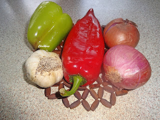 different vegetables, onions red and green peppers, garlic