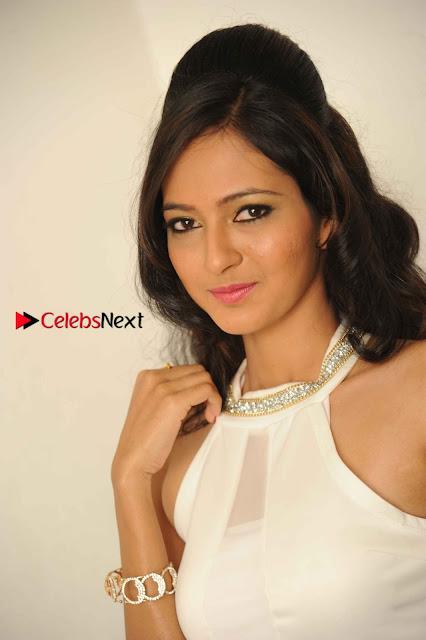 Kannada Actress Nidhi Latest Pos in White Short Dress at Vega Movie Launch Press Meet  0001.jpg