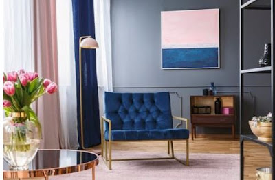 grey livingroom with blue and gold chair pink curtains