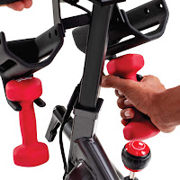 Dumbbell holders, water bottle holders, resistance adjustment knob, image, on Schwinn IC4 Indoor Cycle Spin Bike