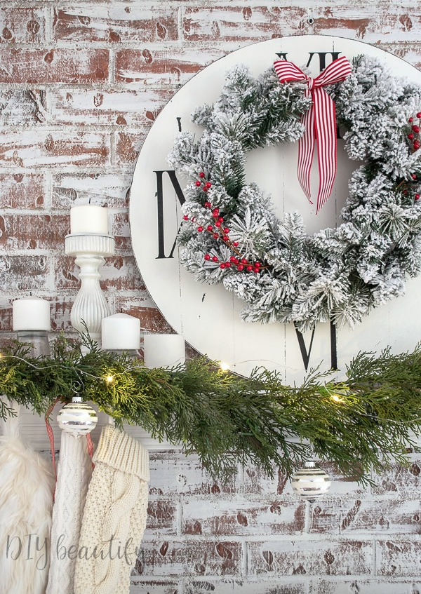 how to layer items on a Christmas mantle