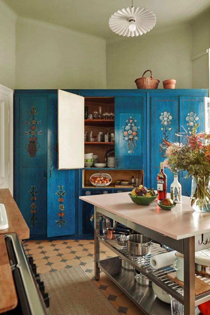 Charming kitchen with blue cabinet