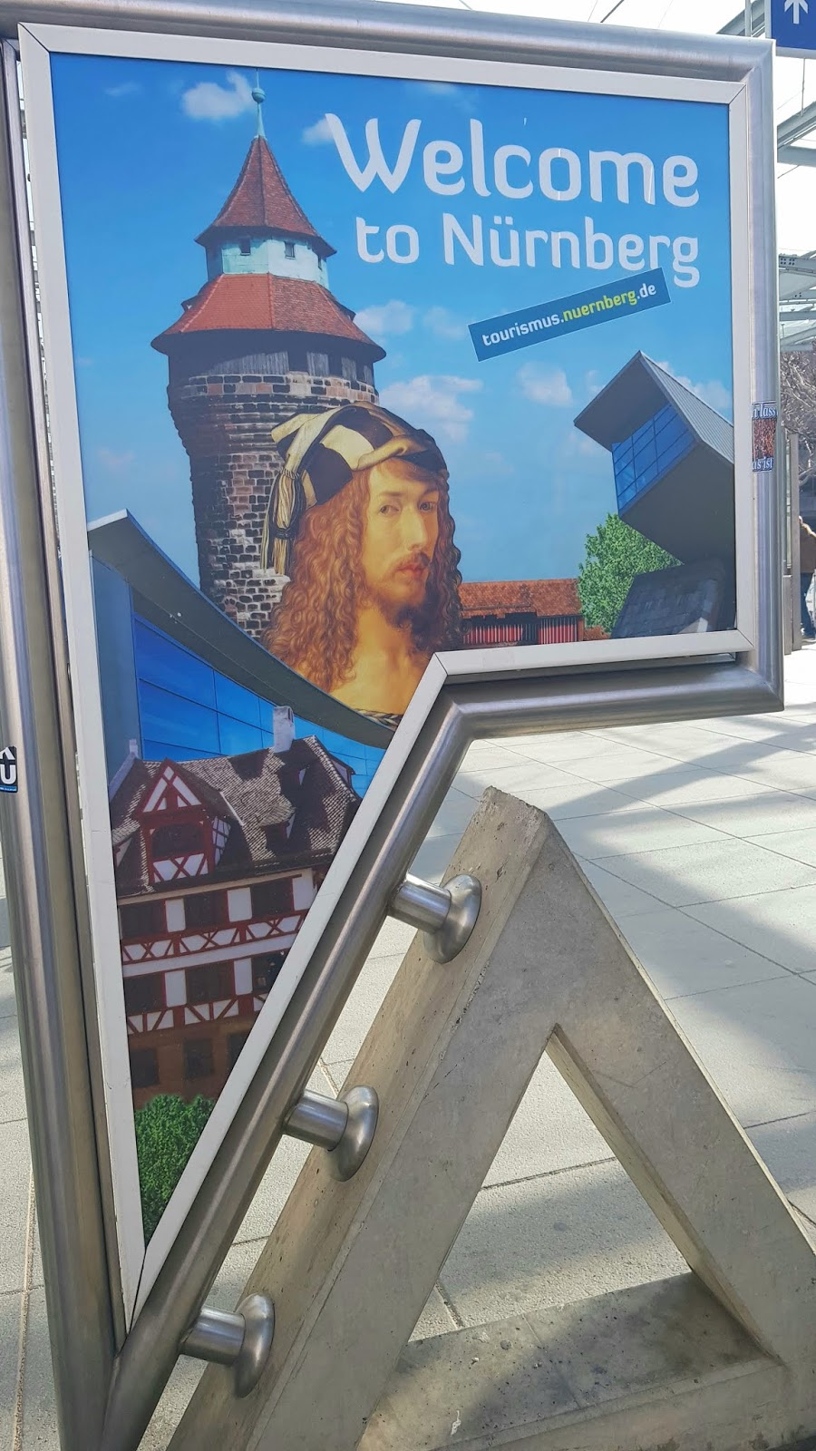 The welcome to Nürnberg sign at the airport in Germany, featuring local hero, artist Albrecht Dürer