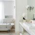 Banheiro branco com banheira vitoriana e mármore paraná nuvolatto!