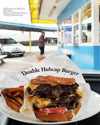 A double hubcap burger with seasoned fries at the Yellowjacket Drive In in Sheridan