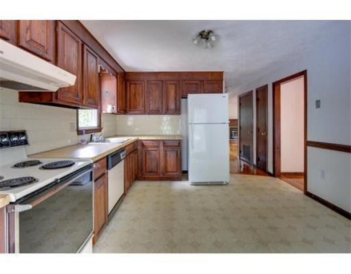outdated 70s L shaped kitchen long view