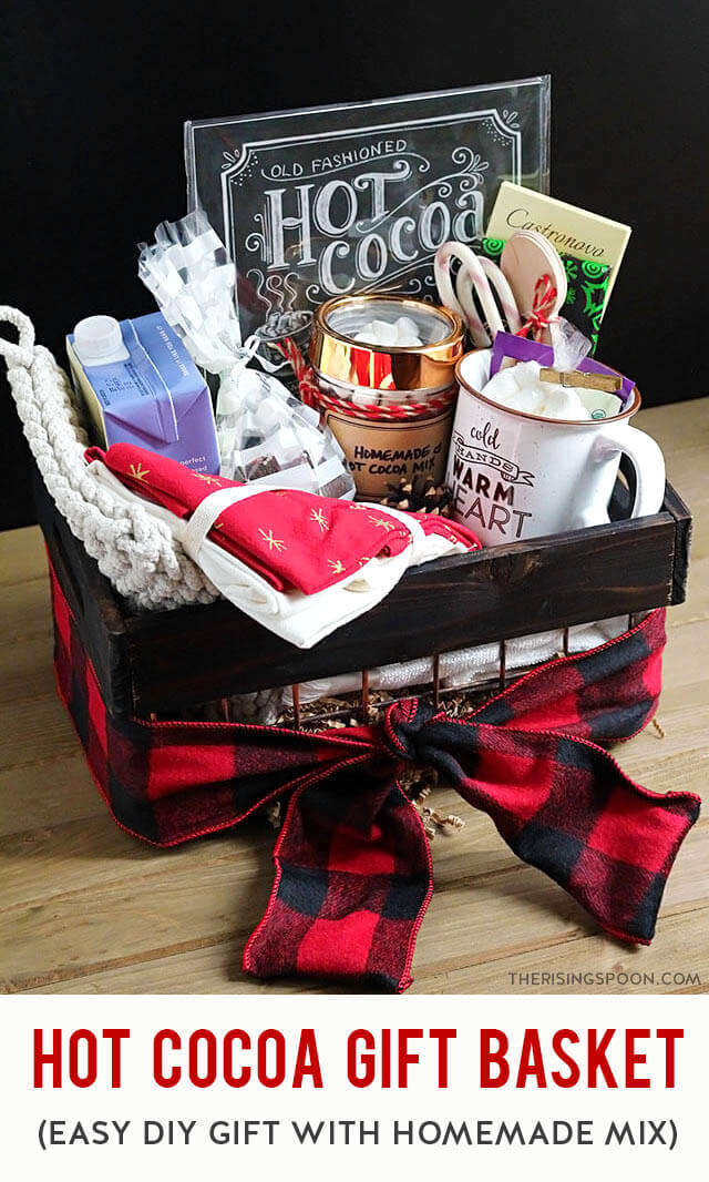 Learn how to put together a cozy & festive DIY hot cocoa gift basket in minutes with a homemade hot cocoa mix (easy recipe included), marshmallows, bar chocolate, and a few other fun goodies (like hot chocolate bombs). This makes a simple, yet thoughtful gift for all ages & any occasion.
