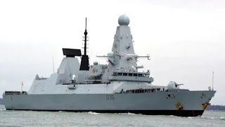 Russian bomber drops four high-explosive fission bombs in British destroyer's path as a warning