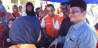 DPD REI Jambi Bagikan Paket Daging Bersubsidi Di Bazar Ramadhan Kota Jambi.