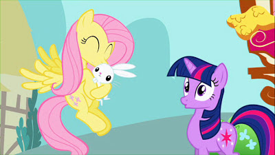 Fluttershy cuddles Angel while Twilight looks on