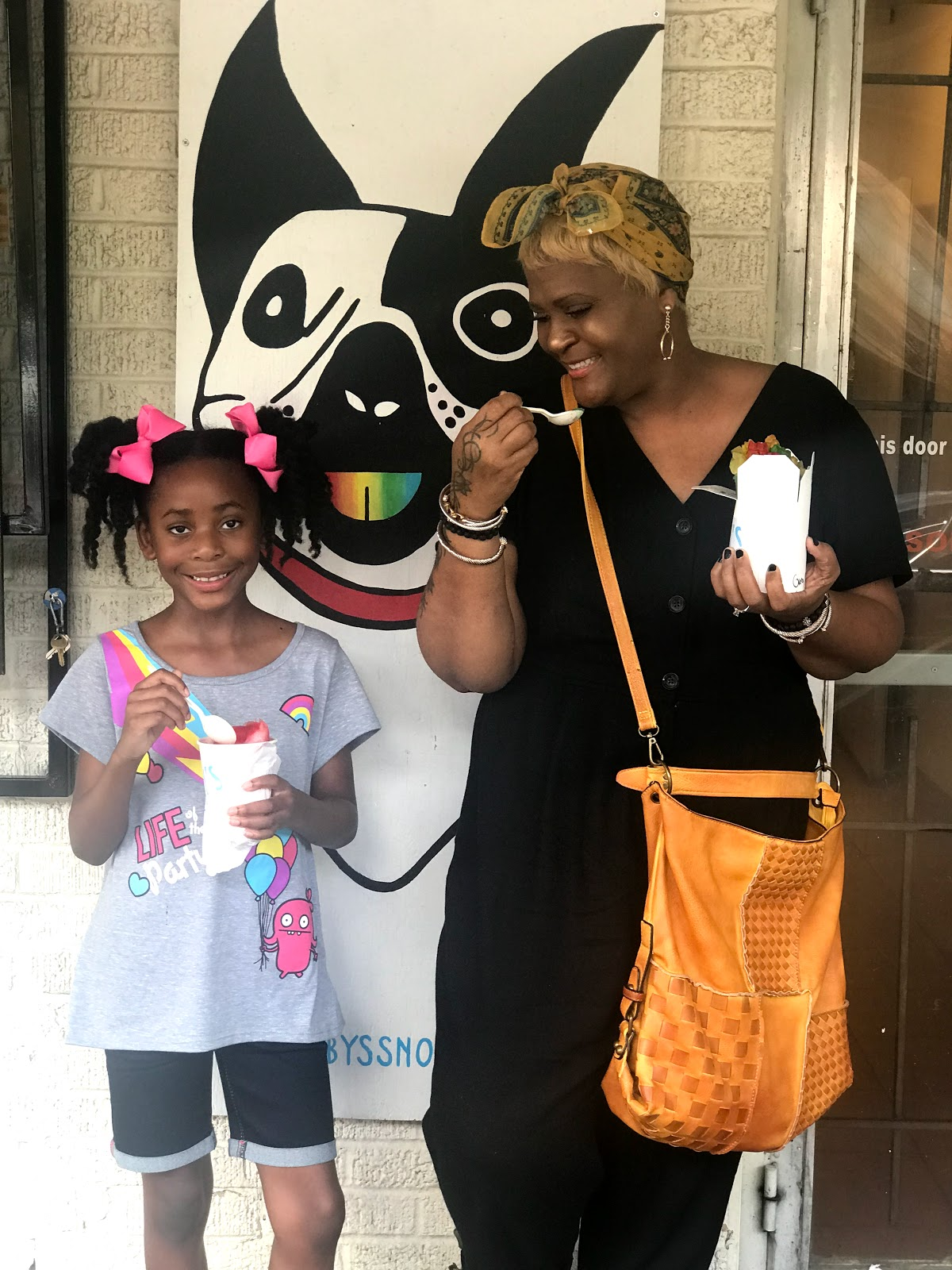 Image: Mom and Daughter posing for pictures at Ruby's snow cone place in Dallas Texas
