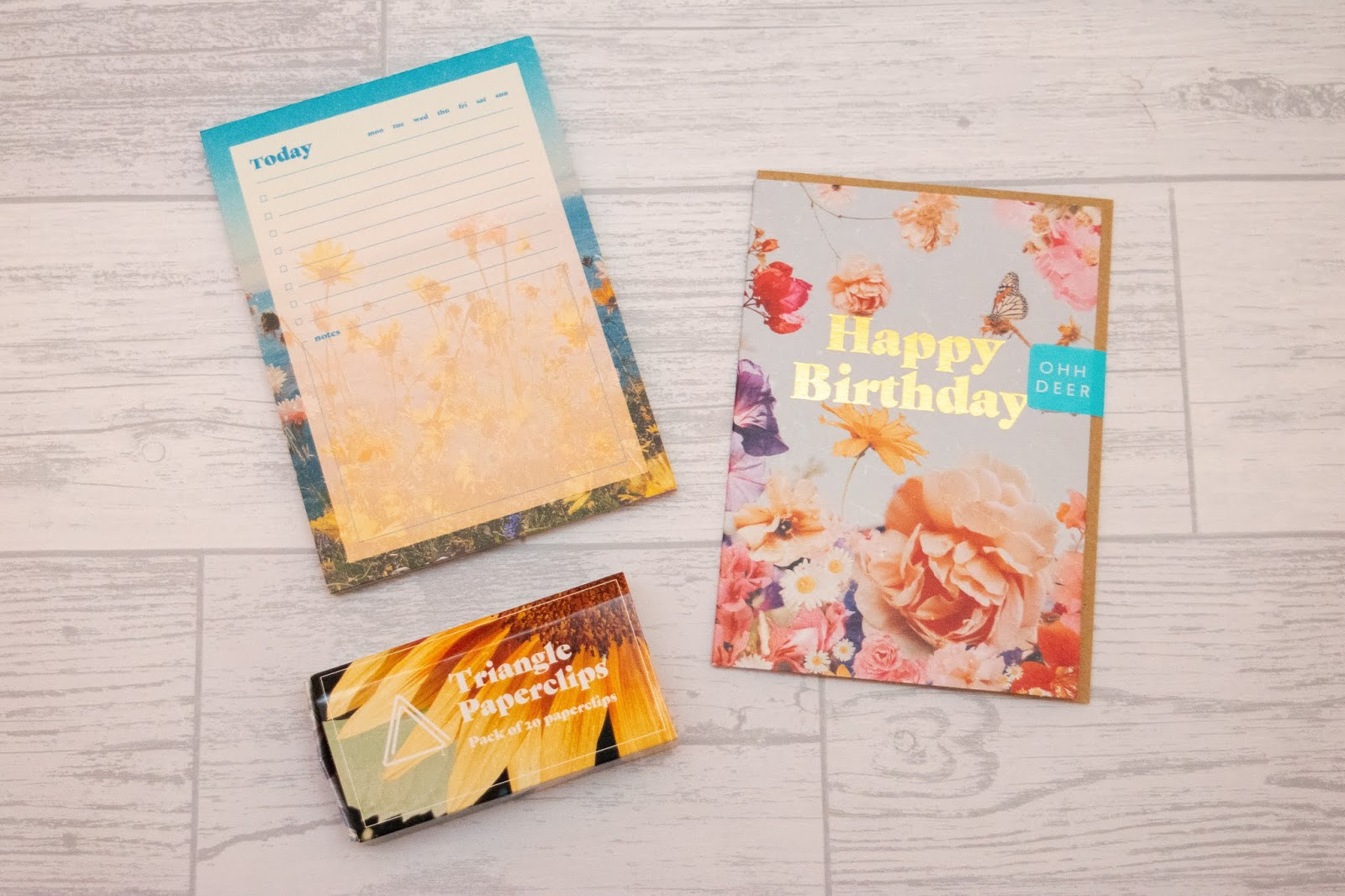 A list pad, box of paperclips and a birthday card