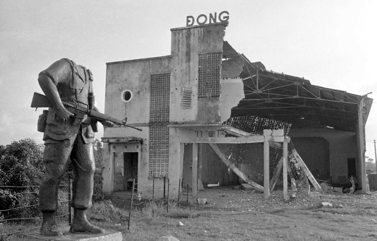 A beheaded statue of an American soldier stands next to a bombed-out theater near the district town of Cu Chi, northwest of Saigon, on December 13, 1972. The statue was placed by troops of the U.S. 25th Infantry Division before they were withdrawn from Vietnam two years earlier. Its head was lost in the explosion that destroyed the theater in background.