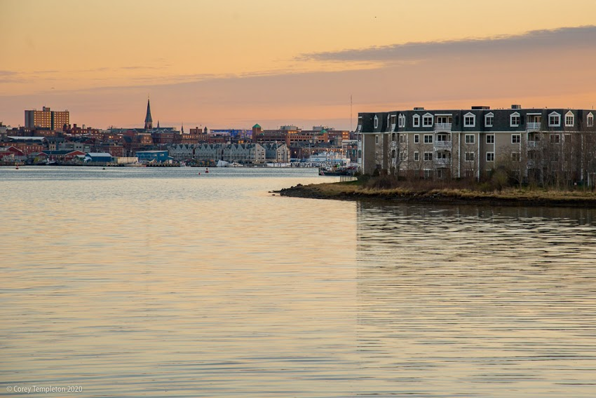 Portland, Maine USA April 2020 photo by Corey Templeton. Calm waters this morning. Looking towards the Old Port from South Portland.