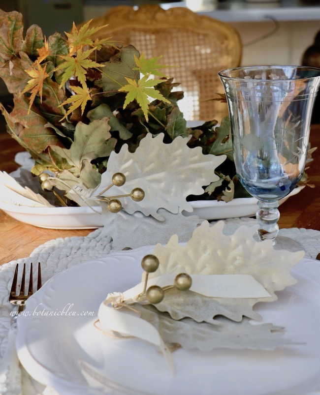 Thanksgiving Natural Centerpiece tips for using twigs, leaves, and acorns show the back side of the centerpiece