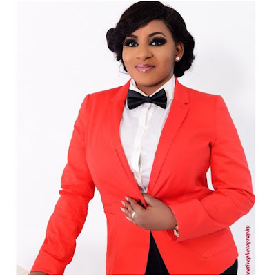 mide martins in suit