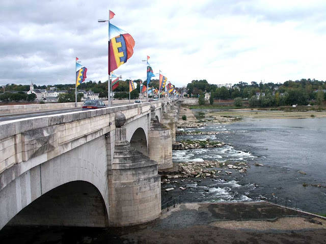 Pont Wilson on the Loire in Tours.  Indre et Loire, France. Photographed by Susan Walter. Tour the Loire Valley with a classic car and a private guide.