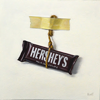 small trompe l'oeil acrylic painting of hershey's chocolate bar hanging from a piece of twine