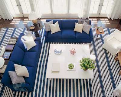 Nautical Themed Living Room with Navy Striped Rug