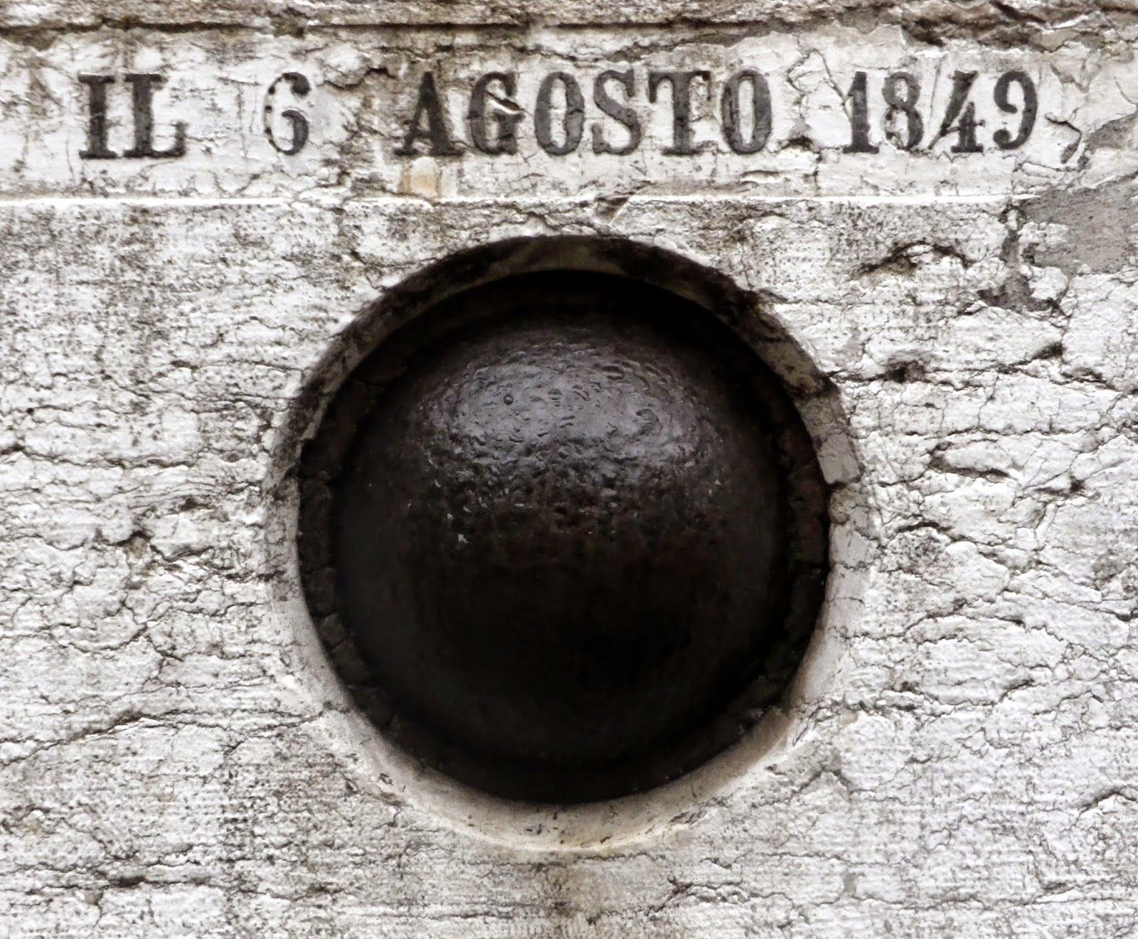 A cannonball embedded into the church of San Salvador in Venice.