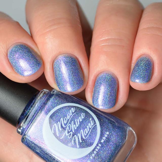 indigo holographic nail polish four finger swatch