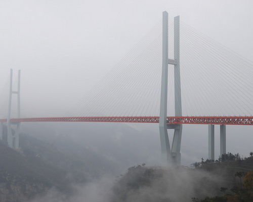 Tinuku.com Beipanjiang Bridge, the highest in the world at 564 meters above Beipan river, linking Guizhou and Yunnan
